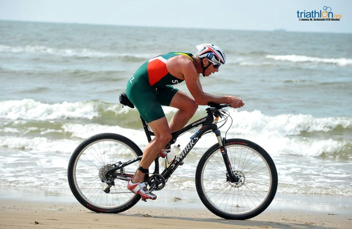Conrad Stoltz Caveman ITU Corss Triathlon Worlds 2013 World Champion Specialized Sworks Epic 29er Specialized Evade helmet beach racing
