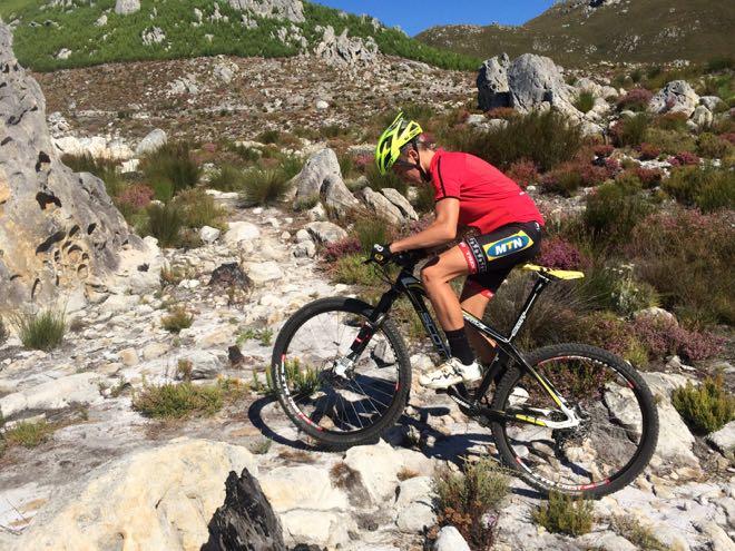 Conrad Stoltz Caveman MTB Skills clinic Jarrett Esterhuizen climbs