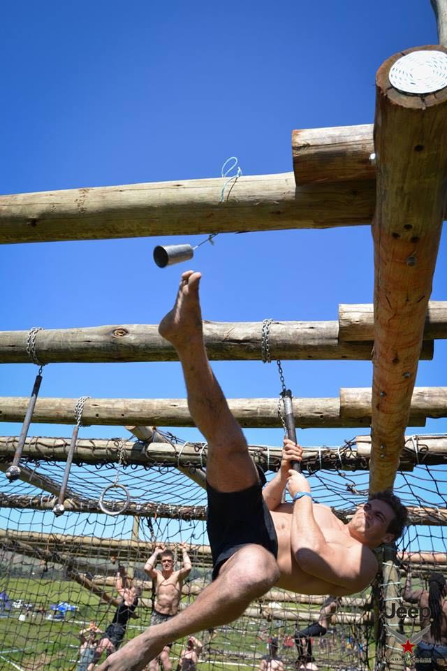 12063548 Warrior Black Ops Elite competitor ringing the bell Conrad Stoltz Caveman
